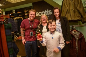 Kenzie Appleton, who has launched an appeal for toys for Alder Hey Hospital, where he is being treated  for Perthes Disease, pictured with John Franklin, manager of Scotts Manager, Church Square Deputy Manager Margaret Jones and  his mum Tara Hewitt
