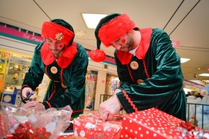 The elves wrapping presents.