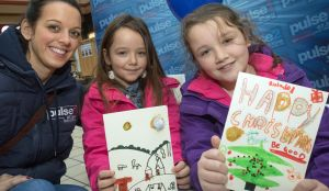 Christa Dapolito of Pulse 1, joins card designers Leah Armstrong, seven, and Bryony Armstrong, nine, (right) of Silsden