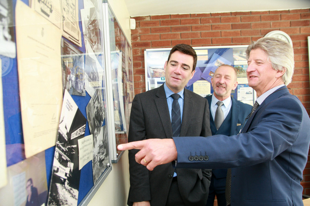 Leigh MP Andy Burnham with Astley Hire operations director Michael Dorricott (centre) and commercial director Stephen Dorricott, looking at memorabilia from the company's 50-year history
