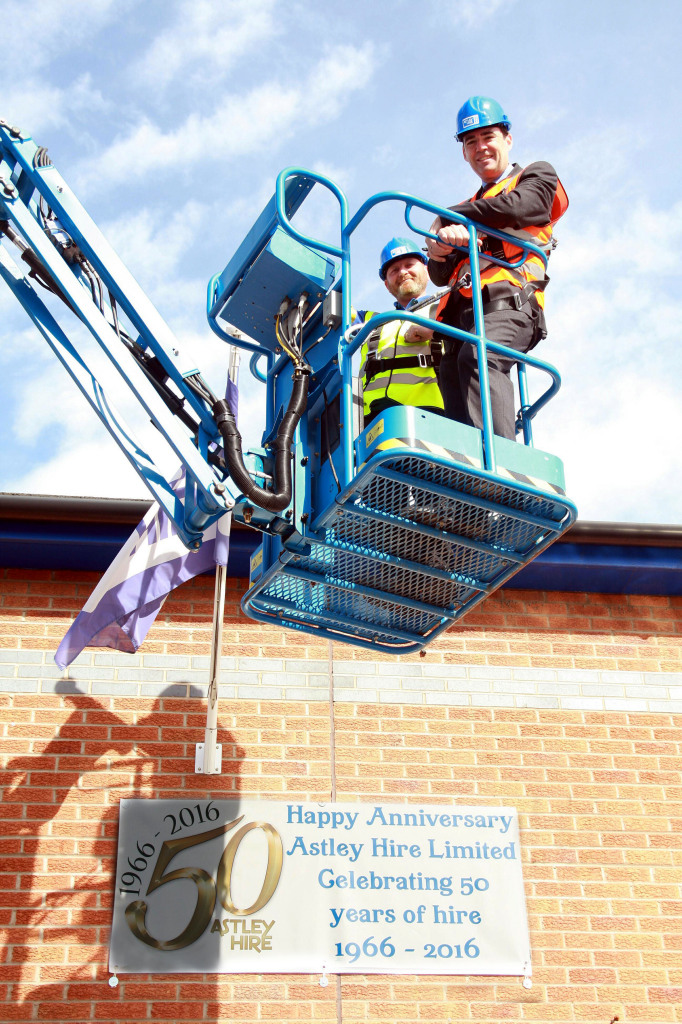 Leigh MP Andy Burnham gets a bird's eye view of Astley Hire from a cherry picker with service engineer Thomas Warburton