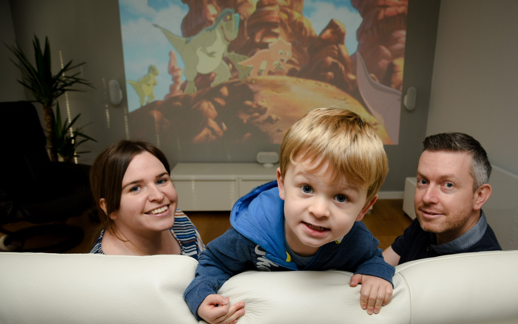 Frodsham film buff Paul Williams, his wife Caroline and their  three-year-old son Tommy with his newly built home office and micro-cinema built by Rubicon Garden Rooms
