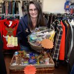 Volunteer Jan Rae with the shop's Christmas raffle